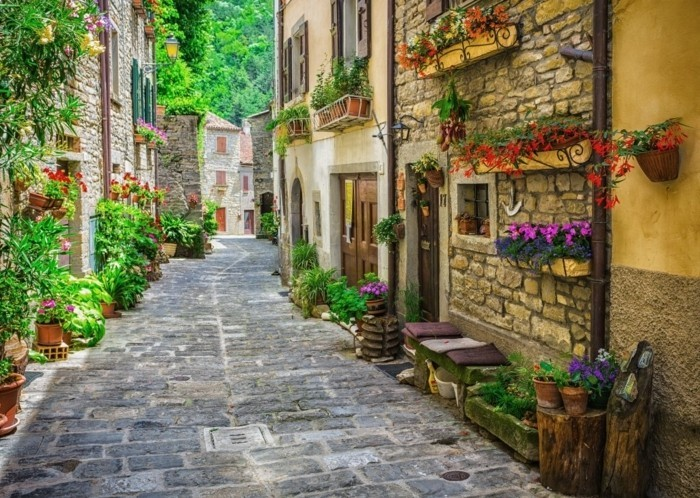 ITALY - JUNE 23, 2014: Typical Italian street in a small provincial town of Tuscan, Italy, Europe