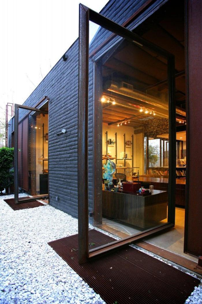 La porte coulissante en verre gain d 39 espace et for Decoration porte verre