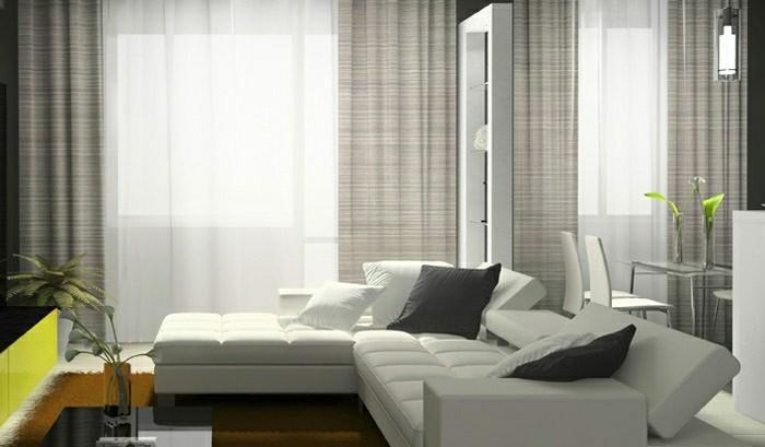 salon-bien-aménagé-double-rideaux-design-canapé-d-angle-blanc