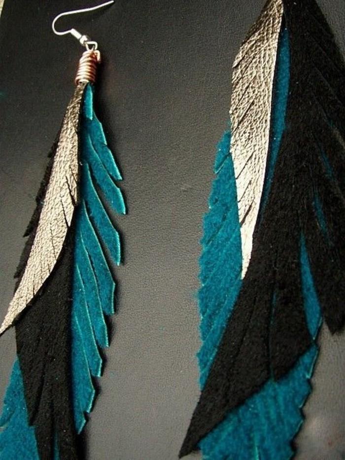 joli-boucle-d-oreille-plume-de-couleur-bleu-foncé-boucle-d-oreil-moderne