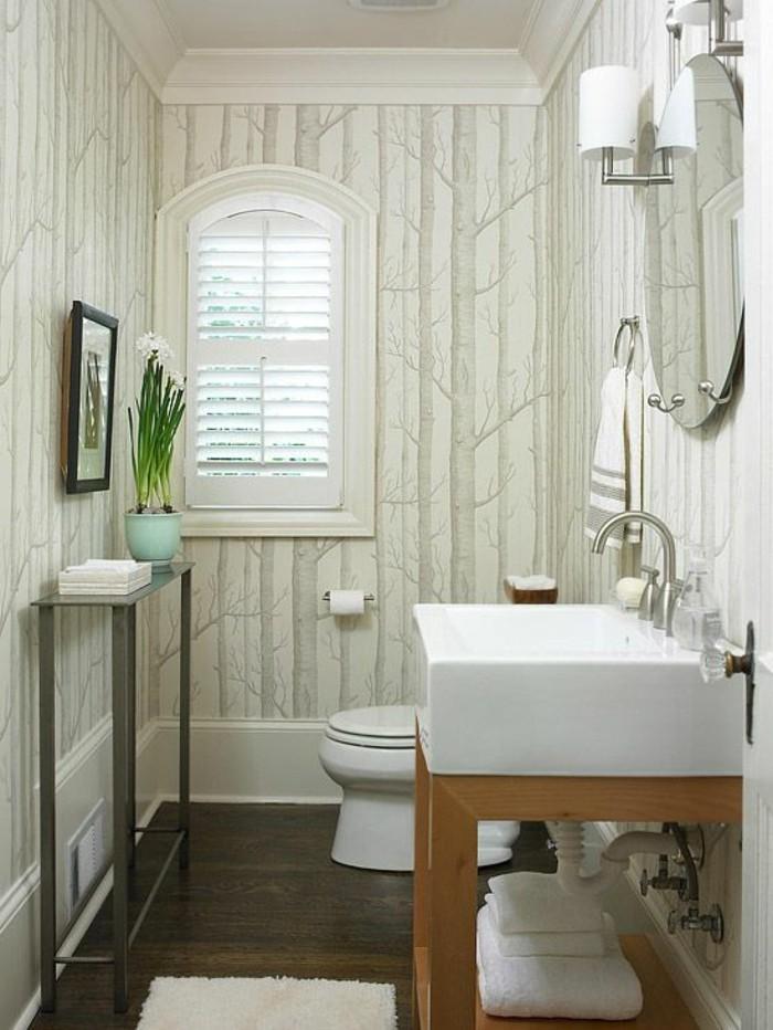 jolie-idee-pour-la-salle-de-bain-meubles-blancs-miroir-rond-sol-en-bois-noir-lampes