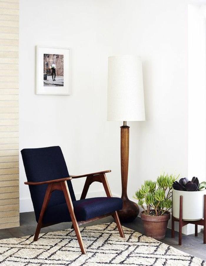 on-vous-presente-fauteuil-cabriolet-fauteuil-crapaud-pas-cher-de-couleur-noir-tapis-beige-et-noir