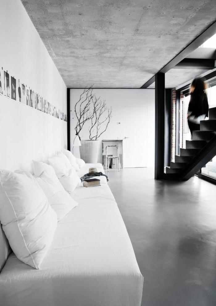 0-salon-avec-un-plan-de-travail-béton-ciré-béton-décoratif-de-couleur-gris-meubles-blancs