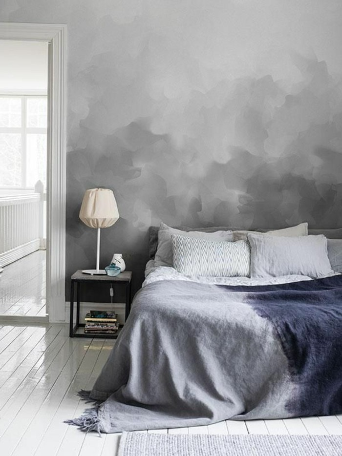 Agréable-ambiance-dans-la-belle-pièce-peinte-en-couleur-tendance-pour-chambre-à-coucher-voir-le-gris-a-la-mode