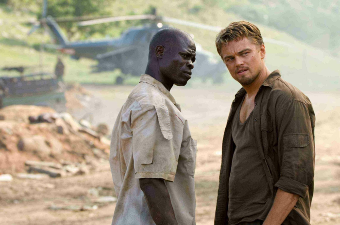 "LEONARDO DiCAPRIO stars as Danny Archer and DJIMON HOUNSOU stars as Solomon Vandy in Warner Bros. Pictures' and Virtual Studios' action drama ""Blood Diamond,"" distributed by Warner Bros. Pictures. PHOTOGRAPHS TO BE USED SOLELY FOR ADVERTISING, PROMOTION, PUBLICITY OR REVIEWS OF THIS SPECIFIC MOTION PICTURE AND TO REMAIN THE PROPERTY OF THE STUDIO. NOT FOR SALE OR REDISTRIBUTION."