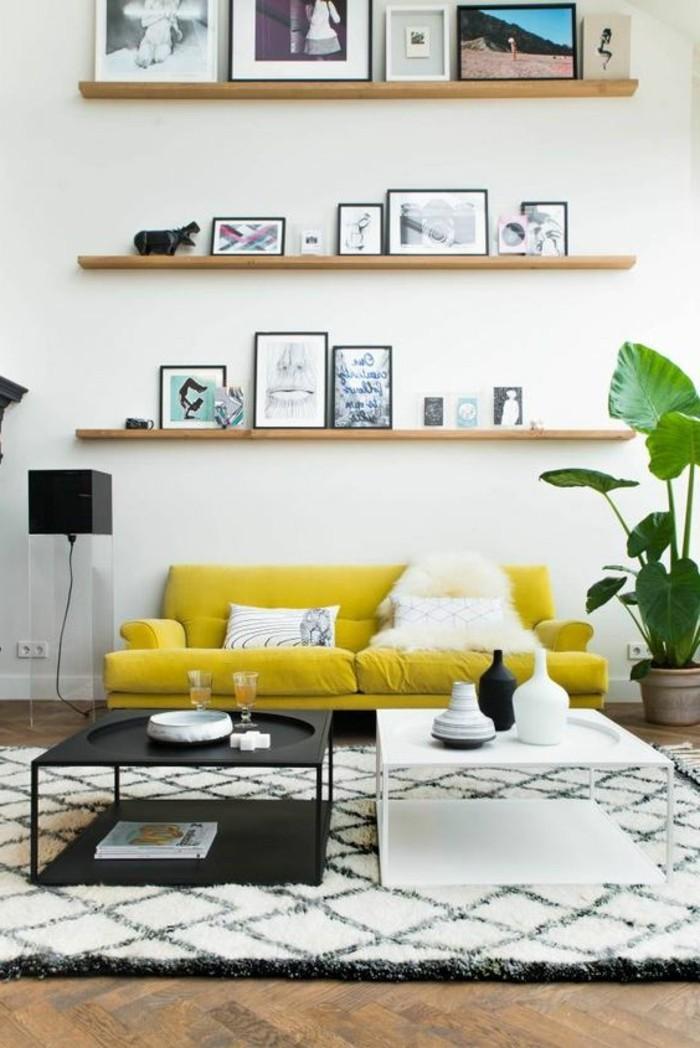 canape-jaune-tapis-blanc-noir-table-de-salon-blanc-noir-meubles-de-salon-assortir-les-couleurs-d-intérieur