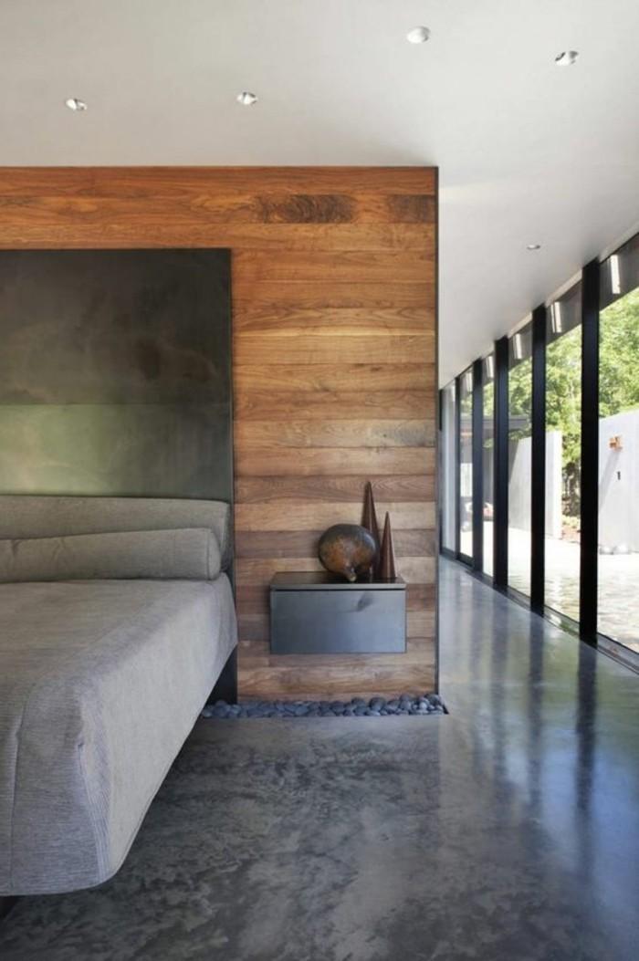 chambre-a-coucher-grise-beton-decoratif-plan-de-travail-béton-cire-grandes-fenetres