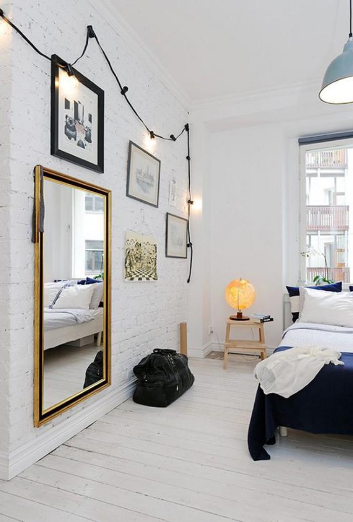 miroir-doré-chambre-à-coucher-scandinave