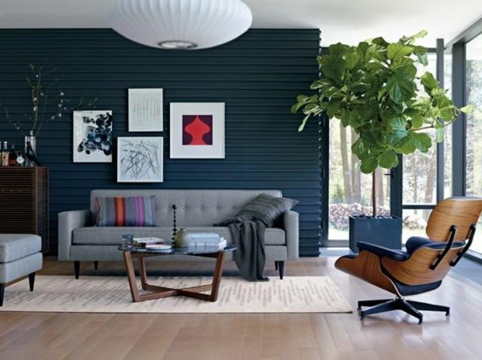 salon-chic-sol-en-parquet-clair-tapis-beige-canapé-gris-dans-le-salon-meubles-d-interieur