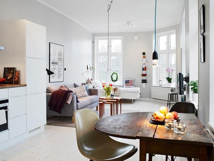 aménager-un-studio-cuisine-table-à-manger-sofa-et-lit