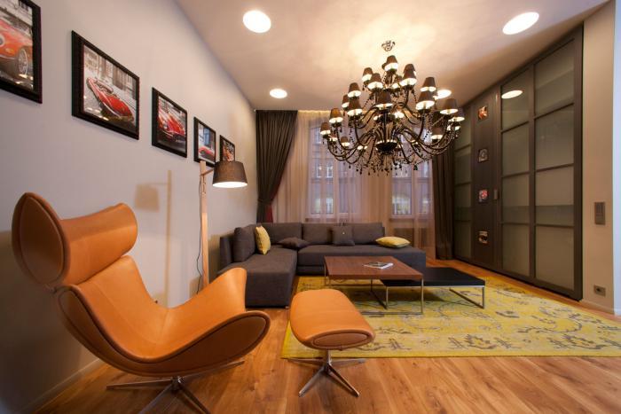 aménager-un-studio-studio-meublé-tendance-grand-fauteuil-et-sofa-d'angle