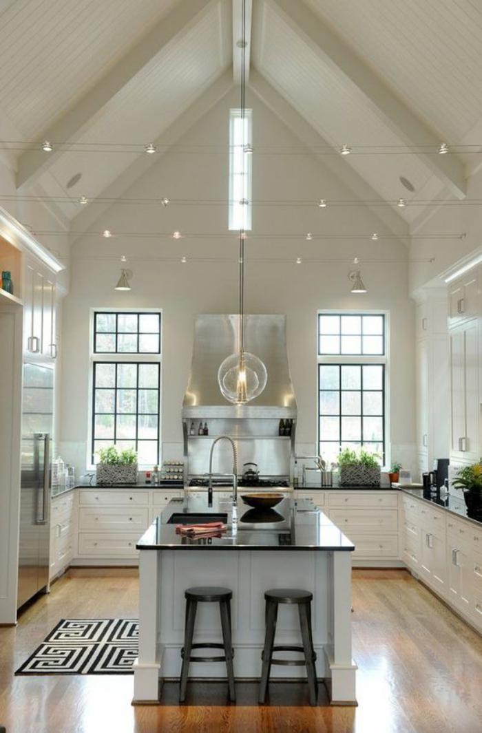 La cuisine avec ilot  cuisine bien structurée et fonctionnelle