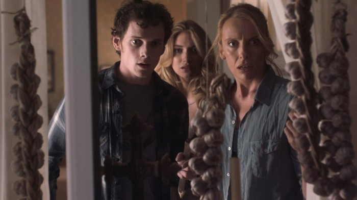 """""""FRIGHT NIGHT"""" FN-031 Charley Brewster (Anton Yelchin, right), his mom Jane (Toni Collette, left) and girlfriend Amy (Imogen Poots, center) are terrorized by a bloodthirsty vampire in DreamWorks Pictures' horror film """"Fright Night."""" Directed by Craig Gillespie, """"Fright Night"""" is produced by Michael De Luca and Alison Rosenzweig. ©DreamWorks II Distribution Co., LLC. All Rights Reserved."""