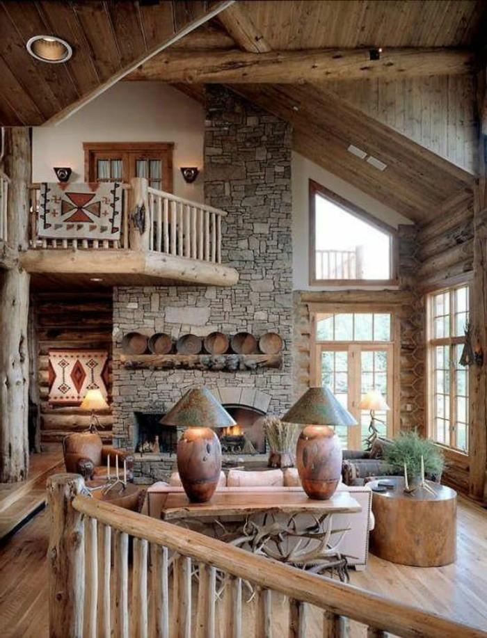 salon-chic-mur-de-pierres-interieur-en-bois-clair-grandes-fenetres