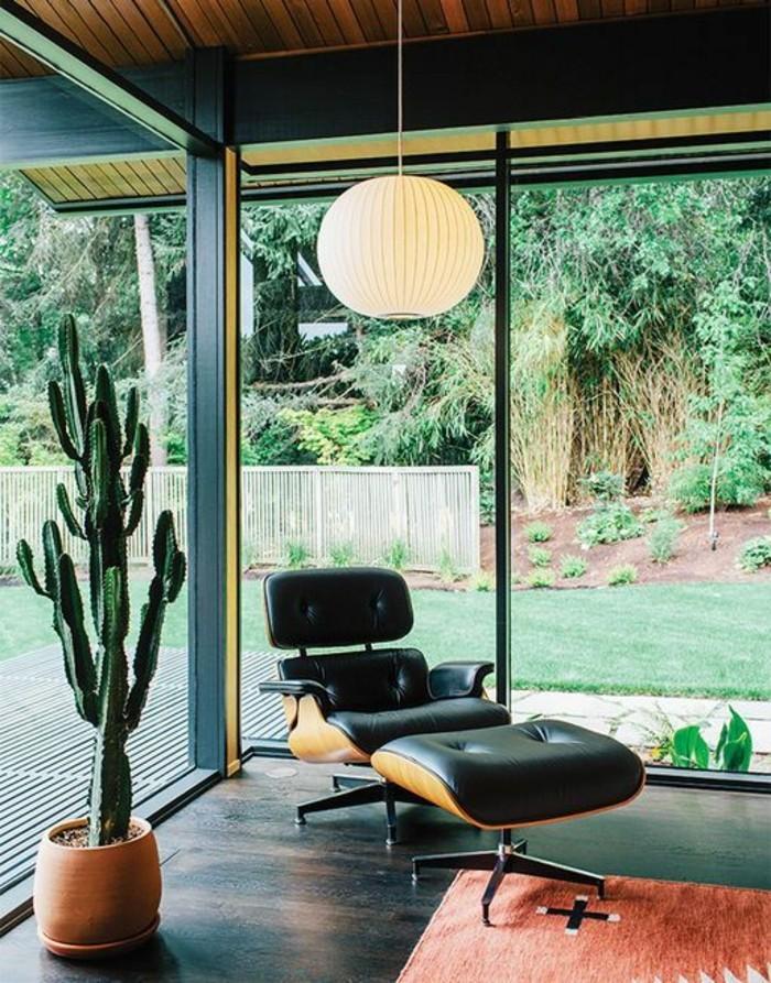 tapis-de-salon-blanc-rouge-chaise-en-cuir-noir-fenêtre-de-salon-avec-belle-vue