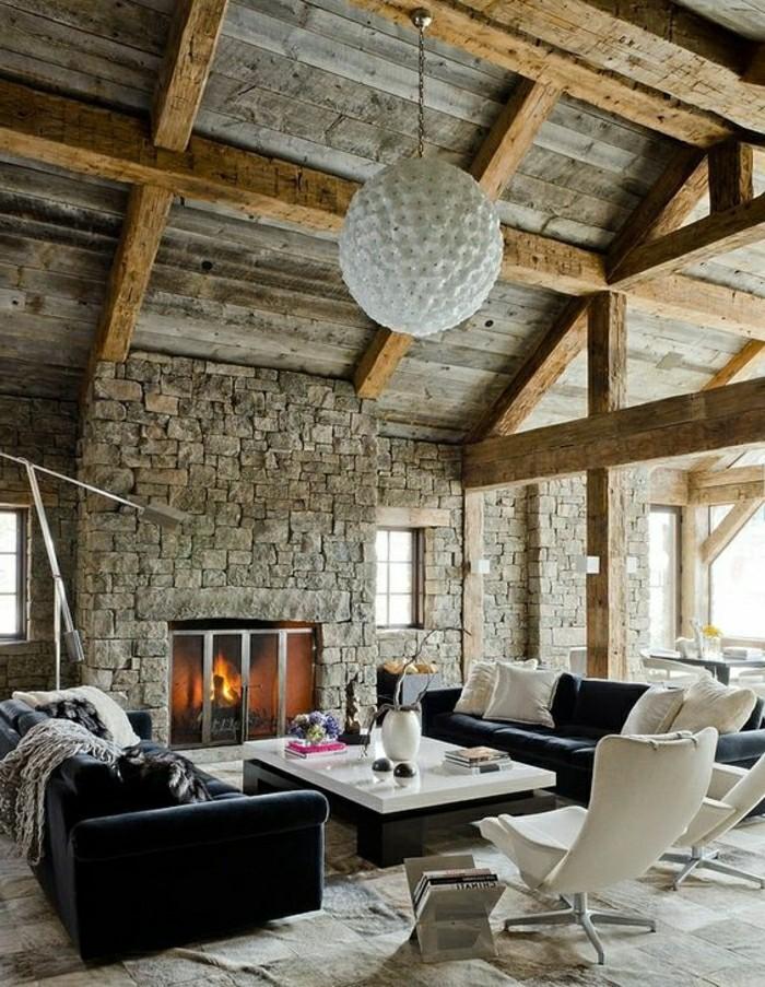 1-salon-avec-decoration-murale-en-pierres-gris-lustre-boule-blanc-chaises-blancs-dans-le-salon-resized