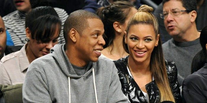 Entertainers Jay Z and wife Beyonce attend the Brooklyn Nets against the Los Angeles Clippers NBA basketball game on Friday, Nov., 23, 2012, at Barclays Center in New York. (AP Photo/Kathy Kmonicek)