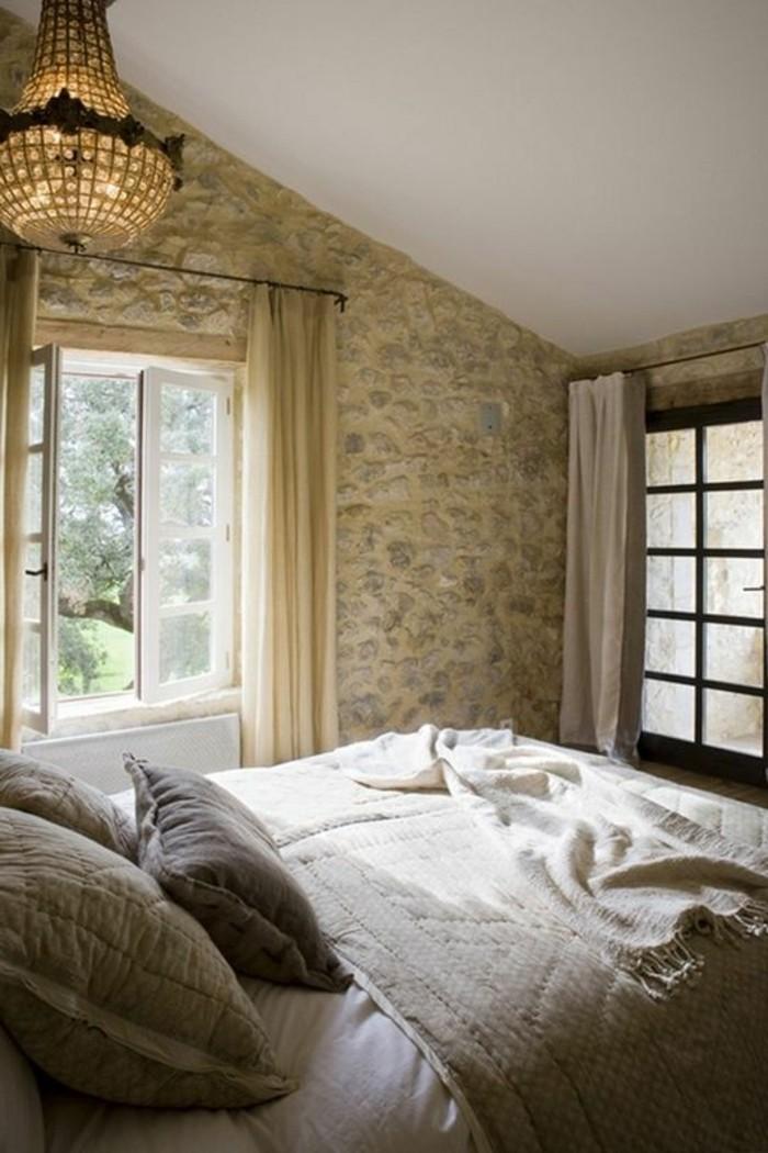 chambre-a-coucher-parement-de-pierre-linge-de-lit-gris-coussins-de-lit-gris