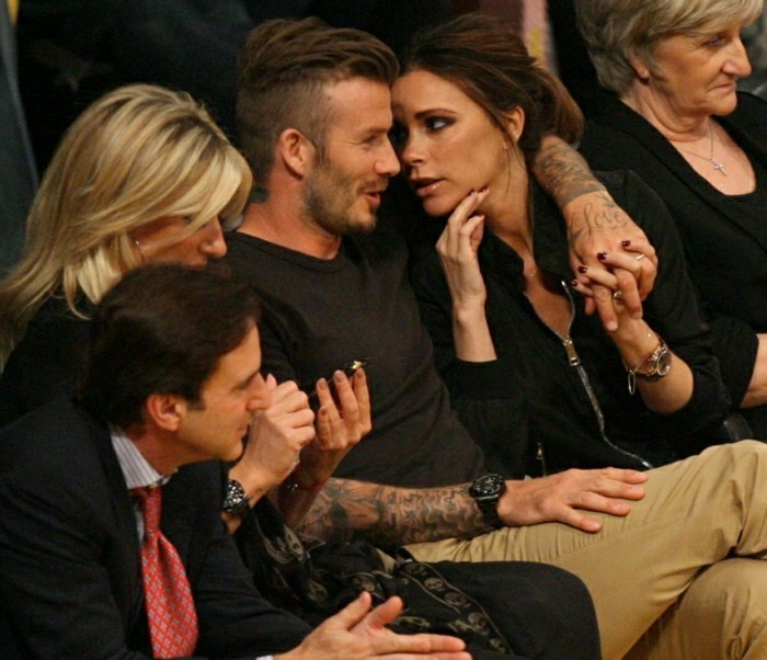 David Beckham and Victoria Beckham display some affection and laughs as they watch the Los Angeles Lakers Vs The Denver Nuggets with his sister Joanne and mom Sandra, the popular footballer who is a regular at Lakers games and his Spice Girl wife enjoyed a kiss for the Kiss Camera at Half time the night before his 37th birthday Pictured: David Beckham, Victoria Beckham and Sandra Beckham Ref: SPL387069 020512 Picture by: London Entertainment / Splash Splash News and Pictures Los Angeles: 310-821-2666 New York: 212-619-2666 London: 870-934-2666 photodesk@splashnews.com