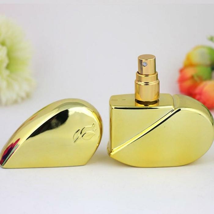flacon-de-parfum-en-forme-de-coeur-resized