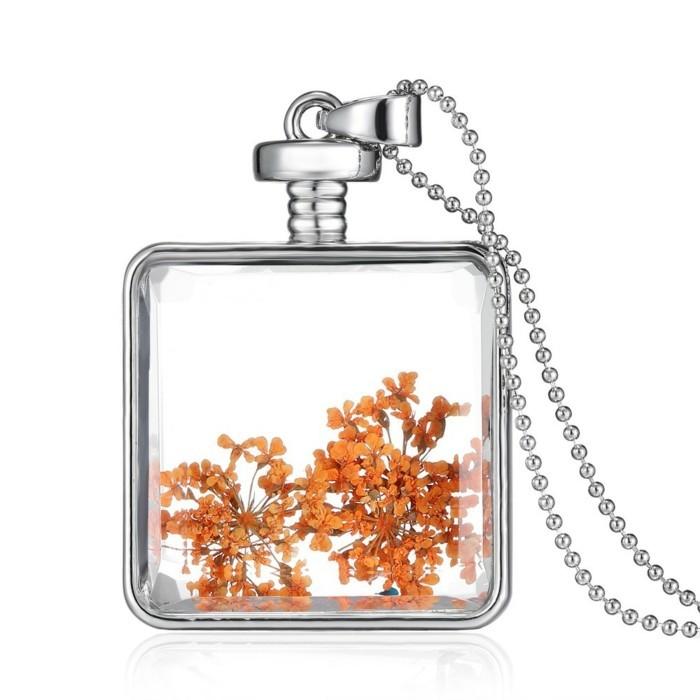 pendentif-argent-bouteille-vintage-au-pot-pourri-orange-resized