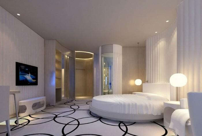 chambre-adulte-originale-lit-rond-sol-en-cercles-noirs-sur-fond-blanc-resized