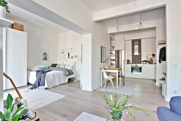comment aménager un studio petit avec kitchentte studio blanche séparée ouverte sur salon et séparé de coin chambre adulte moderne en gris et blanc à deco nordique