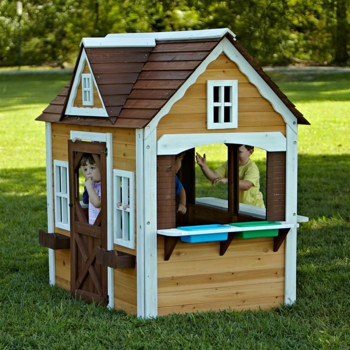 La maisonnette en bois qui aide vos enfants jouer plus for Maisonnette de jardin pour enfant