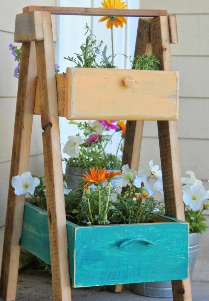 déco-jardin-récup-pots-de-fleurs-avec-objets-récup