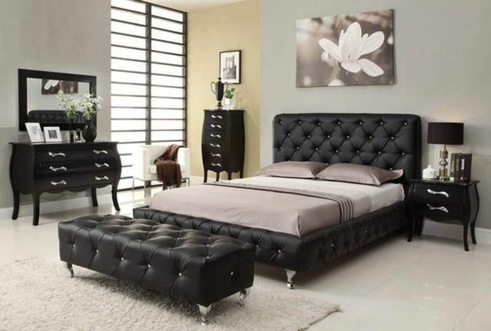 lit-design-180x200-lit-en-cuir-noir-tapis-beige-dans-la-chambre-a-coucher-petits-meubles-en-bois-noir