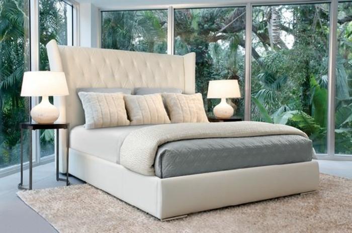 lit-design-pas-cher-en-cuir-beige-tapis-beige-et-murs-en-fenetres-chambre-a-coucher-en-verre