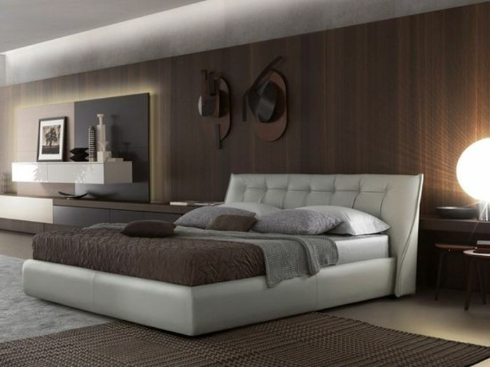 mur-en-lambis-marron-foncé-tete-de-lit-capitonné-en-cuir-blanc-chambre-a-coucher-parentale