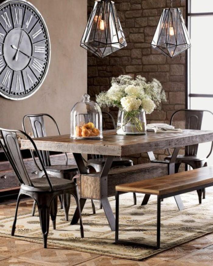 table-en-bois-massif-marron-foncé-tapis-beige-mur-en-briques-marrons-lustres-en-verre