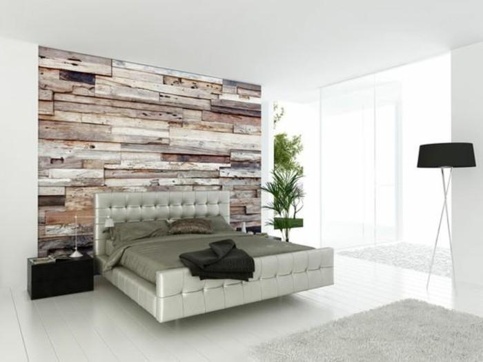 tete-de-lit-capitonnée-simili-cuir-lit-en-cuir-gris-mur-en-lambris-bois-decoratifs-tapis-gris