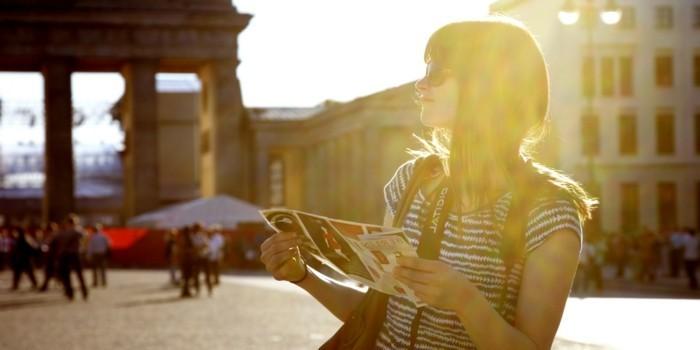 Girl with map at Brandenburger Tor