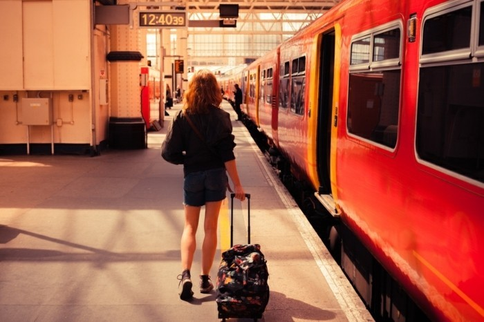 A young woman is about to board a train