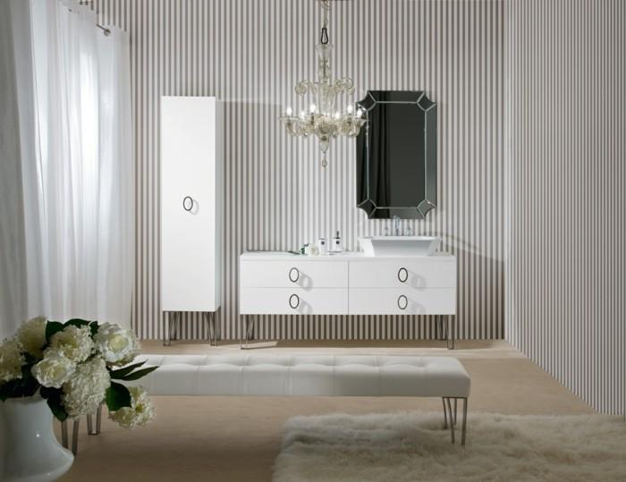 39-Exemple de salle de bain au lit, au tapis et aux placards blanc