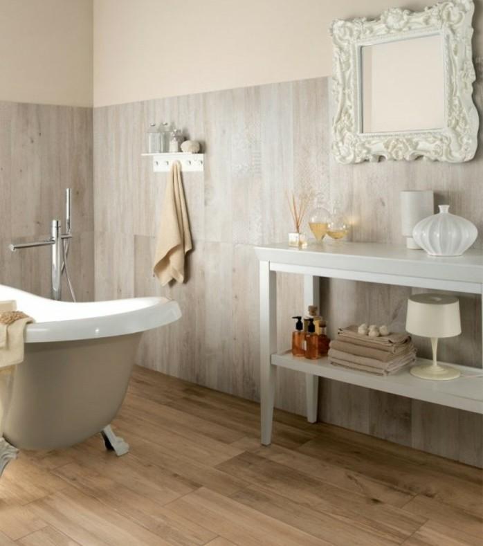modele-salle-de-bain-vintage-chic-miroir-avec-joli-encadrement-jolie-baignoire-à-poser-espace-de-rangement-idée-carrelage-salle-de-bain-imitation-parquet