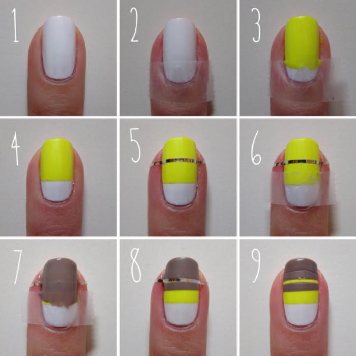 déco-ongles-originale-avec-bandes-adhésives-manucure-en-blanc-et-jaune