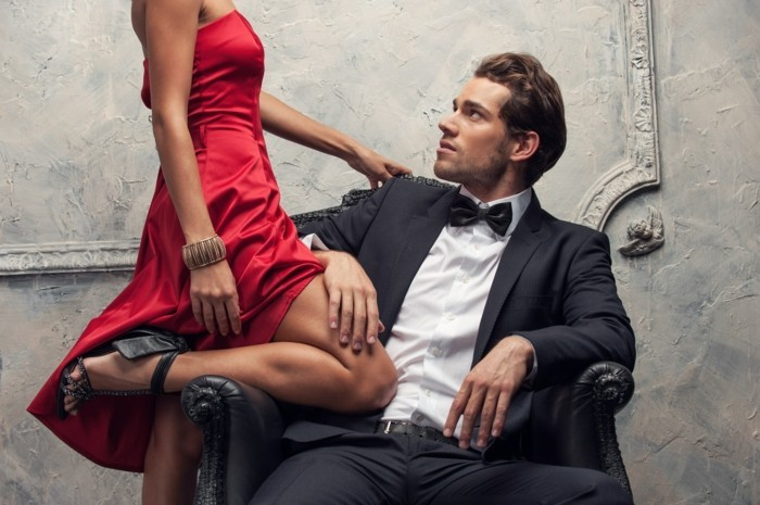 Elegant couple passing in classic clothes. Close up, cut shoot