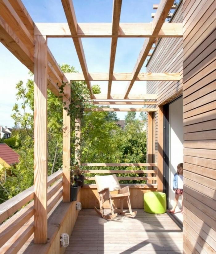 pergola-terrasse-en-bois-chaise-à-bascule-éclairage-intégré-design-très-esthétique