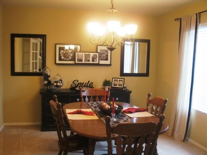 peinture-salle-à-manger-jaune-chaises-et-table-en-bois-quelques-accents-noirs-ambiance-chaleureuse