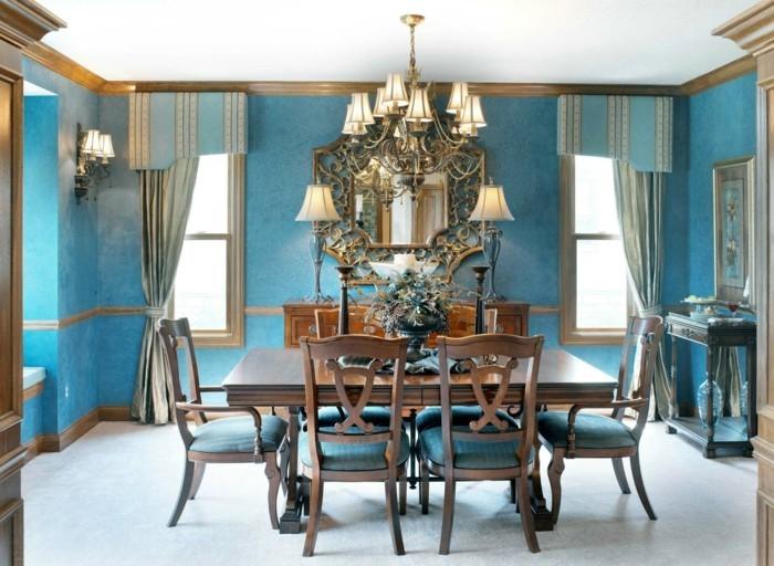 peinture-salle-à-manger-bleue-meubles-en-bois-marron-décor-exubérent-lustre-et-miroir-design-intéressant