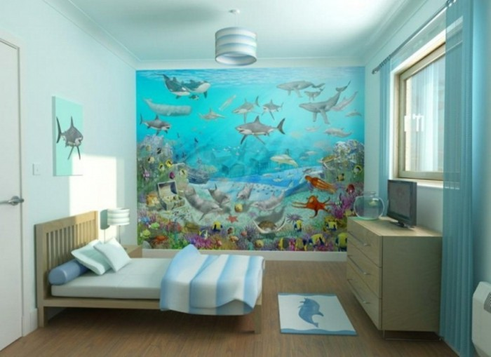 magnifique-suggestion-peinture-chambre-enfant-blanche-avec-un-mur-d-accent-représentant-les-fonds-marrins-thème-ludique-joyeuse