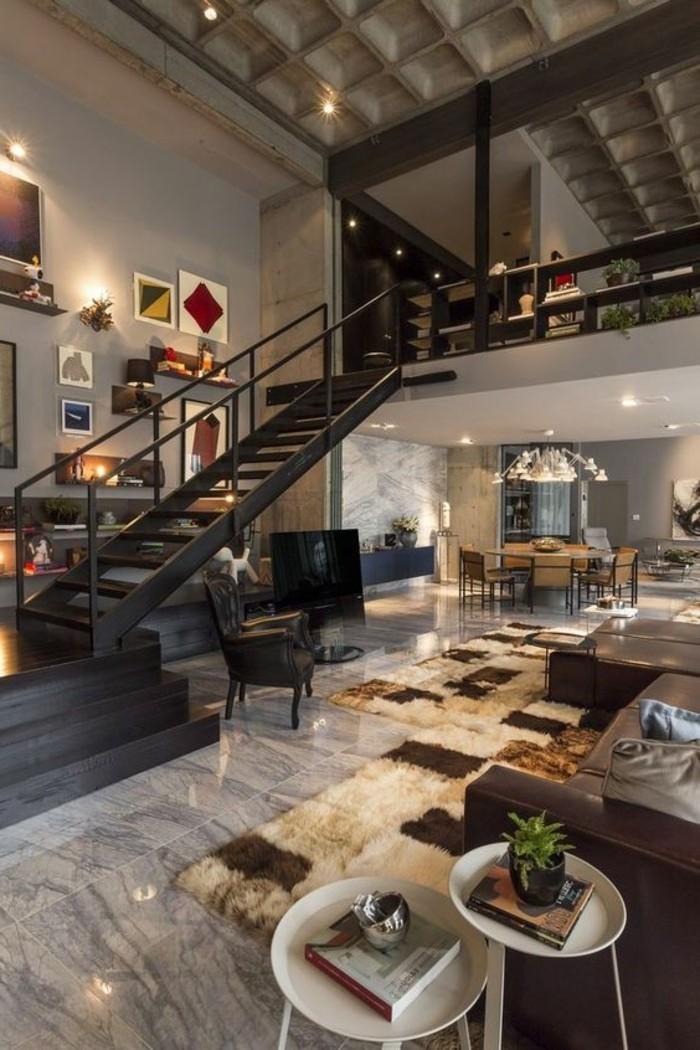 interieur-style-industriel-escalier-tournant-en-bois-noir-sol-en-dalles-gris