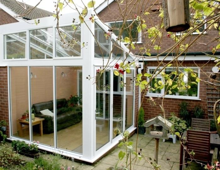 modele-de-veranda-en-aluminium-veranda-toit-plat-en-verre-parois-latéraux-en-verre