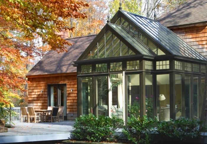 modele-de-veranda-moderne-construction-en-harmonie-complète-avec-la-maison-un-paysage-pittoresque