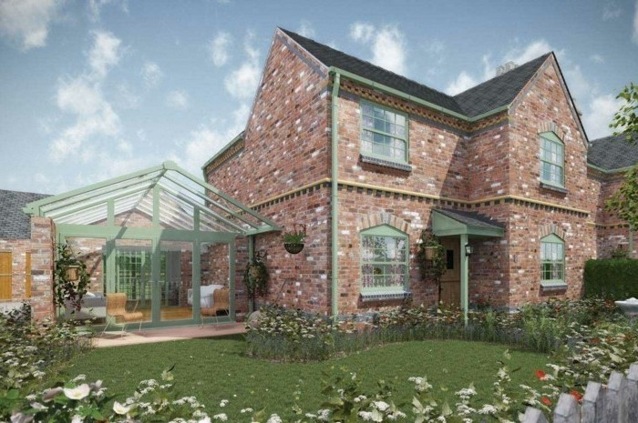 veranda-contemporaine-en-uPVC-et-verre-un-joli-complément-moderne-à-cette-maison-rétro