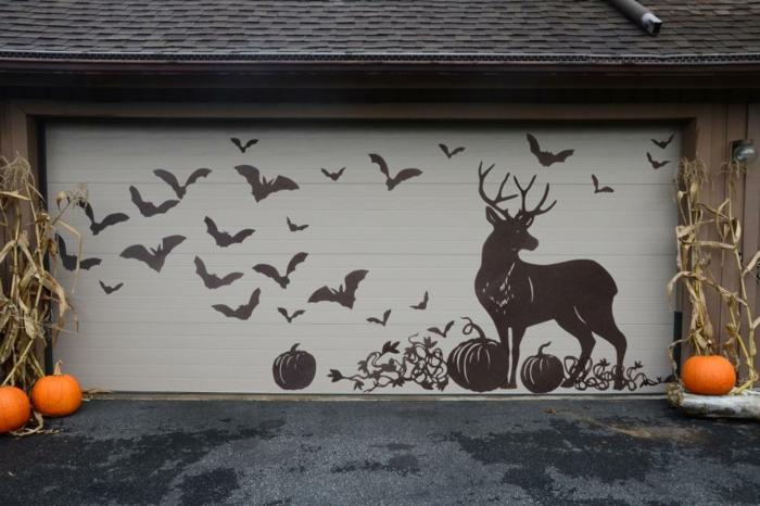 un-joli-sticker-mural-a-appliquer-sur-la-porte-du-garage-figures-macabres-citrouilles-bricolage-halloween-idee-originale