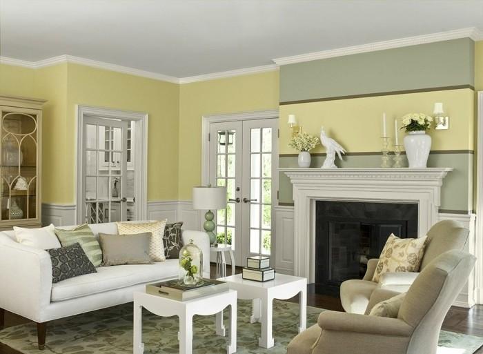 couleur-peinture-salon-jaune-canape-blanc-fauteuils-gris-petites-tables-blanches-cheminee-elegante-style-raffine